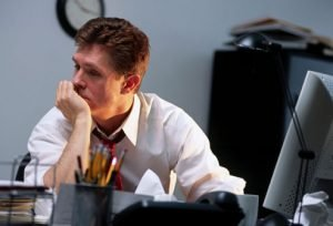 photolibrary_rm_photo_of_worried_man_at_desk